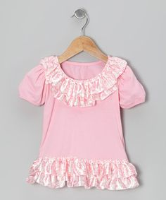 Satin ruffles at the neckline and hem of this tunic give it a dose of fancy frills. Made from soft knit fabric, it's a comfy choice for pairing with leggings or jeans.
