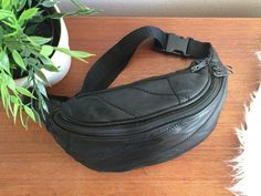 Black Patchwork Leather Fanny Pack / Black Leather Hip Bag / Black Bum Bag / Leather Hip Sack / Adjustable Belt Fannypack / 80s Leather Bag  Vintage patchwork soft black leather fanny pack with 2 pockets and an adjustable buckle strap Nice unisex gift idea  Measures: 10 wide x 4 tall strap is 13 wide at shortest and latched and 19 across at longest (double that for waist circumference)  CONDITION REFERENCE CHART RATING: Very Good one small patch on the bottom of the back of the bag slightly…