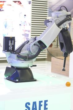 """During EMO Milano, in a Pick & Place demo, Racer999 not only proves its speed, it also gives a demonstration of the #Comau Safe technology.  Racer999 is a six-axis articulated robot which has inherited all the key features of its """"older brother"""" Racer 7-1.4. With a reach of under a meter in length (999mm), it is particularly suited for applications in a limited space including assembly, handling, machine tooling, packaging and more."""