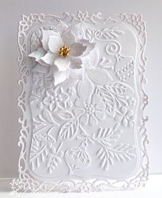 handmade Christmas card ... white on white ... gorgeous embossed pine boughs and foliage .. die cut and layered white poinsettia ...  a WOW look .....