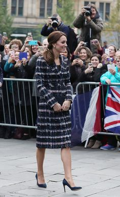 The Duchess wore an Erdem coat and a black vintage blouse for an away day in Manchester ...