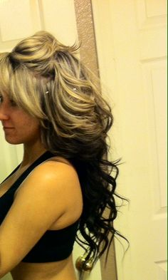 Blonde and dark brown underneath...like this...need a new hair color maybe this