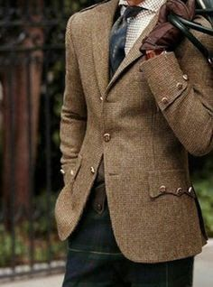 The colour of Marks jacket and he will now be wearing the Grant hunting tartan, so a green/blue tartan similar to this.