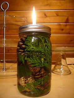 mason jar oil lamp...I've made these before, they are are easy, got the wick and holder at Michael's, and the oil lamp oil at the Dollar store, just add pretty stuff to jar, and add oil.