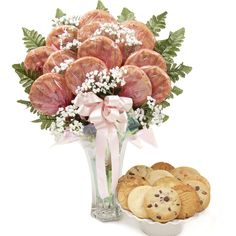 A fancy cookie bouquet to welcome baby girl! Trust me…Mom will eat them for her! ;-) www.bellablumbaskets.com