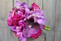 purple hydrangea, plum stock, deep purple calla lilies, and lavender mokara orchids with bright and fluttery accents of purple vanda, raspberry dendrobium, and fuchsia phalaenopsis orchid blooms 1