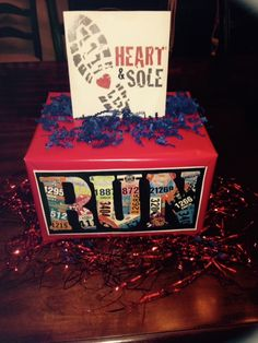 OMHS XC Centerpieces  (dollar store boxes/wrapping paper/two run items printed from internet/ filler confetti from dollar store)