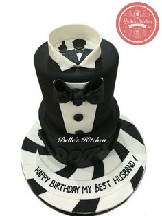"""Ian Fleming's """"James Bond"""" 2 Tier Cake By Belle's Kitchen, To Order Contact Our WA: 081294055786, Line: Bellekitchen, Also Be Sure To Follow Our Instagram @belle_kitchen"""