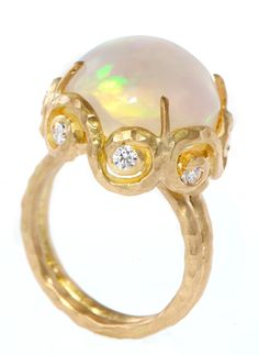 Love this style of Opal setting!