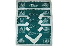 """Four placemats with a dark green background reverse-printed with fun places to visit in Southern California: Grauman's Chinese Theater, the Mission at San Juan Capistrano, Knott's Berry Farm, and more. The four coordinating napkins (11""""Sq) feature the same green background but have """"California"""" written in one corner."""