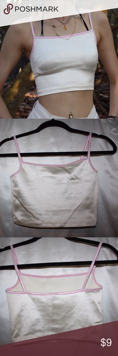 American Apparel crop tank Light cream color American Apparel crop tank with pink trim. Beautiful reflective fabric. Great condition. Size S, fits like S but has some stretch American Apparel Tops Crop Tops