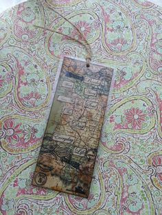 Handmade bookmark. I used some world map printed wall paper, distressed it up a bit with coffee and tea and made a vintage looking bookmark. So if you have any old wallpaper which you love then use it and make some thing which will be worthy to keep forever😉