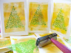 Gold background is created with a brayer. Top design is made with a hand-cut stencil.