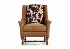 Pampa Wing Chair --- Silhouetting a bull, the Pampa is a sleek and whimsical version of a traditional wing chair. Get your stirrups and giddy up!