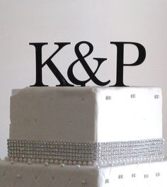 Large Black Two Initials Cake Topper. $30.00, via Etsy.  May need to check on rush shipping