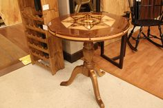 A beautifully designed wooden table with gorgeous detail on its top! | Houston TX | Gallery Furniture |