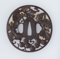Tsuba with design of grapes. Japanese Edo period–Meiji era. mid-19th century. Nakagawa Itteki (Japanese, 1835–1885 Japanese), School Ichijô School (Japanese)