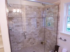 beautiful design. Just needs fancier shower heads and some places for shampoo, etc