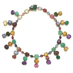 GEM SET NECKLACE, SEAMAN SCHEPPS, 1980S Designed as a fringe of oval cabochon gem stones, including rubies, sapphires, green beryls and tourmalines, length approximately 440mm, signed Seaman Schepps.