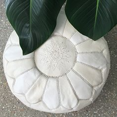 Moroccan Leather Pouffe – White – Maison & MaisonThese sensational Moroccan pouffes would look superb in any room in the house.  Made from 100% Goat Leather,the single tone floor cushions feature a star design stitched into the top and single colour panelling on the side and underside. They can be used as a foot stool, side table or seating.
