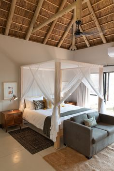 Modern African interior bedroom four poster bed with fitted mosquito net Bedroom Inspo, Bedroom Inspiration, Bedroom Ideas, African Interior, African Home Decor, Mosquito Net Bed, Bed Net, Coxswain, Chiang Rai