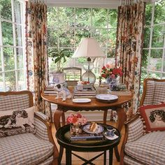 In this happy sunroom, the designer's love of dogs is abundantly evident in the needlepointed spaniel pillows and porcelain bulldog. Interior Designer Charles Faudree