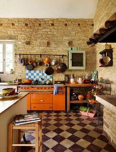 rustic kitchen with orange lacanche stove | interior design + decorating ideas