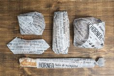 """A student concept design that truly bring sincerity throughout. With a  packaging system that is both practical and eco friendly.The design is  beautiful with handwritten typography, creating a pattern with information.    """"HORNEA is a new wrapping system for bread and pastries adaptable to any  size. It consists of a parchment-paper roll with recipes printed on it,  using only one ecological and recyclable black ink. It's a multifunctional  packaging system, because once used as a take…"""