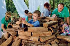 Natural outdoor play spaces (National Wildlife Magazine) -- Children in a nature play area outside the Charlotte Nature Museum in North Carolina.