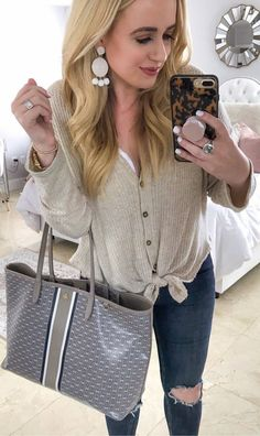 #winter #outfits beige button top, ripped jeans, grey bag