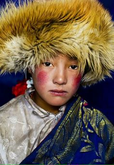 Tibetan girl in Nanyengou, Kham, Tibet, 2005 by Alison Wright                                                                                                                                                     More