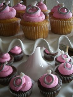Chocolate & Vanilla cupcakes with pink frosting and the ring on top...PERFECT for the engagement party :D