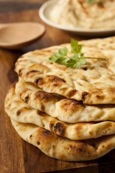 Homemade Naan Recipe - once you've mastered this basic recipe, you can try your own variations by adding garlic to the butter, or other herbs and seeds to the dough. Lunch Recipes, Fall Recipes, Wine Recipes, Indian Food Recipes, Ethnic Recipes, Barley Recipes, Homemade Naan Bread, Recipes With Naan Bread, Basic Bread Recipe