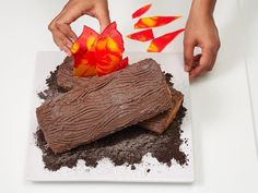 Gather around the campfire...then eat it? These burning logs are actually CAKE! Learn how to make #FNMag's cake by clicking the link in our profile. by foodnetwork