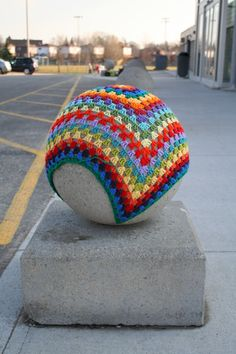 So cool - http://thatsknotart.tumblr.com/post/19610946262/granny-square-2-crochet-march-19-2012