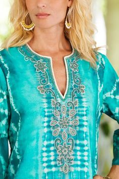 Beautifully embellished, our Nyoman Caftan features elaborate and hand-sewn beads.