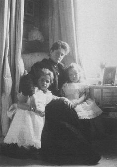 """Empress Alexandra Feodorovna of Russia with her two youngest daughters,Grand Duchesses Maria and Anastasia Nikolaevna Romanova of Russia in the Mauve Boudoir at the Alexander Palace,Tsarskoe Selo. """"AL"""""""