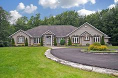 Located on a 5 acre, premium wooded lot in Rideau Forest, this bungalow was custom built for the present owners by John Gerard Homes in 2000. This home offers approximately 3400 square feet on the main floor with a partly finished basement awaiting your personal touch. Oversized five car garage. Enjoy the covered rear porch with an outdoor kitchen that opens to a spectacular pool area.