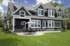 Blue and white home exterior paint colors by Benjamin Moore:  Hale Navy and White Dove.
