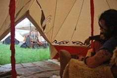 Inside Chieftain's tent, decorated with La Tene style art, pelt lined seats and floor, entry mat of colorful woven sheet. Image from the group TEUTA LINGONES CINGHIALE BIANCO