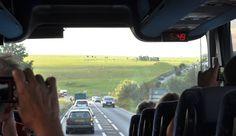 bus driving into Stonehenge