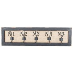 "Some people dread organizing their home or office. Don't be one of those people! Make things easy, fun and beautiful with this Black & Burlap Numbered Wall Hook Plaque. This unique MDF plaque features a lightly distressed black frame, a burlap background with painted black numbers, and amazingly functional double-hooks. Get your entryway, craft room, or kitchen organized with this rustic piece!    	Dimensions:    	  		Width: 29 7/8""  	  		Height: 7 7/8""  	  		Projection: ..."