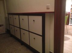 Ikea's shoe cabinets are reported to fit 12x12 just fine.
