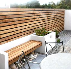 Fresh with a touch of cozy the garden bench bench planters and small contemporary gardens contemporary garden fencing ideas workwithnaturefo