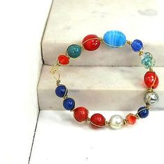 Handmade-bracelet-goldtone-wire-wrapped-red-blue-mix-of-beads-sz-6-3-4-by-Pat2