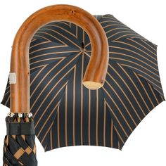 An oversized gentlemen's umbrella with an unbreakable frame made of tempered spring steel, with a handle of polished natural chestnut. The canopy is made of the material used in making the finest ties, and shows a variety of regimental stripes. We also include a black cloth carrying bag to protect the entire umbrella, including canopy and handle.