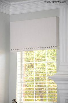 itu0027s overflowing recovered white linen cornice board with upholstery tacks - Cornice Board