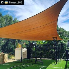 Sail canopy over the MoveStrong T-Rex outdoor functional training station. Backyard gym