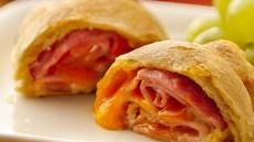 "Ham and Cheese Crescent Roll-Ups...""Love this quick and easy recipe! After a day of work, I don't want to spend a lot of time in the kitchen.  I make the pizza cresents for me w/o meat, because I don't eat meat. For a complete meal, I just pair these with green giant frozen steamers green bean and potatoes, and uncle ben's wild grain rice. So tasty and easy."""