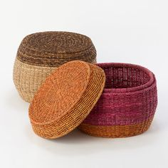 I love the deep rust and cranberry hues of these super functional storage poufs.